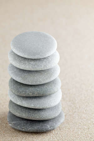 raked: The group of stones lies on small sea sand Stock Photo