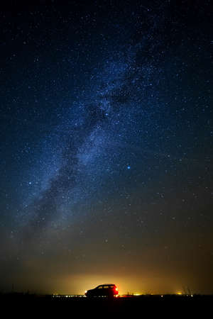 milkyway: The car of the tourist against the star sky. Stock Photo
