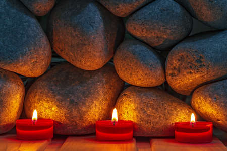 Candles are lit on the background of the sauna stones  Preparing for the ceremony bathhouse