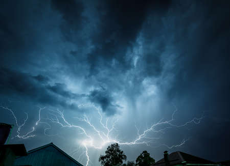 Storm clouds are illuminated from within a flash of lightning. photo