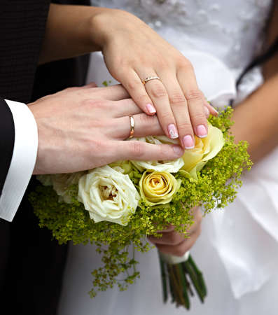 Hands of the groom and the bride with wedding rings photo