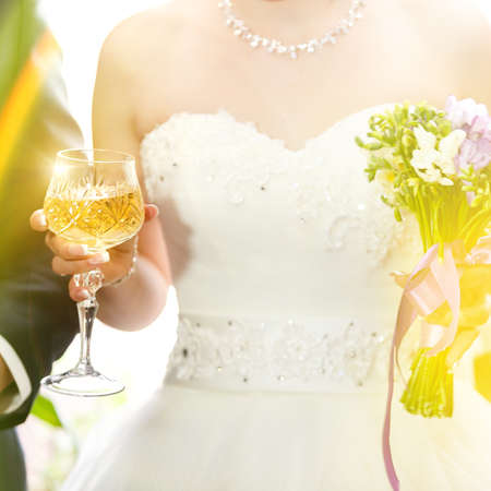 wine glasses in hand bride and groom. photo