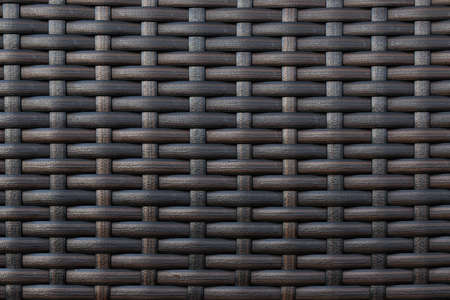 Part of the artificial material braided dark tone. photo