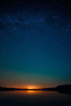 Smooth surface of the lake on a background the starry sky photo