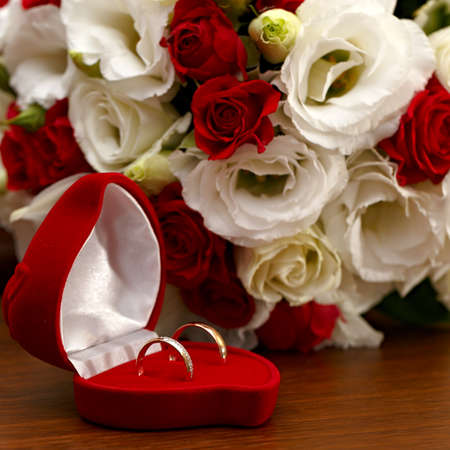 wedding accessories: Wedding rings, gift box and flowers for the bride.