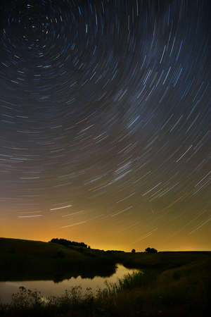 meteors: Star trail in the night sky with bright meteors and aircraft lights.