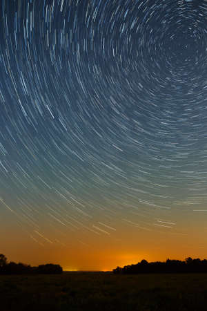 star trail: Star trail in the night sky with bright meteors and aircraft lights.