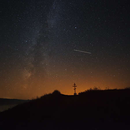researches: The cross on the background of the Milky Way in the night sky. Stock Photo