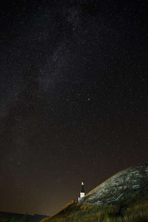 researches: Orthodox Monastery on the background of stars in the night sky. Stock Photo