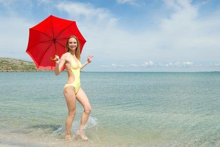 seacoast: The beautiful girl with a parasol on seacoast