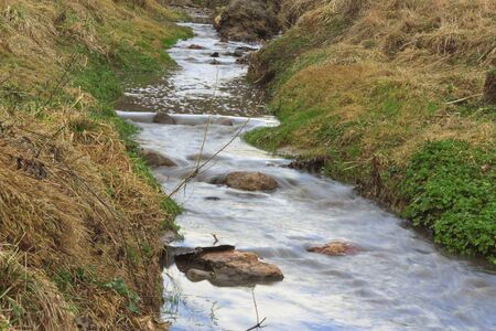 Forest river with rocks and steep banks Stock Photo - 13060585