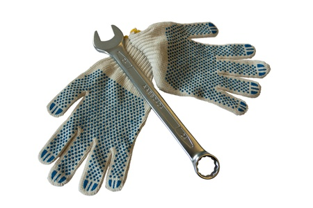 one wrench with gloves isolated on white background photo
