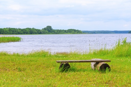 Bench on the shore of beautiful Lake in Braslav Stock Photo - 14330339