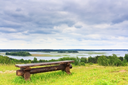 Landscape bench against the backdrop of the Lake in Braslav photo