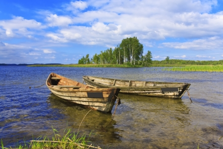 braslav: Two boats on the lake against the blue sky and birches in Braslav Belarus