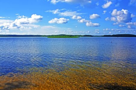 Clear water of the Braslav Lakes against the blue sky Stock Photo - 14517725