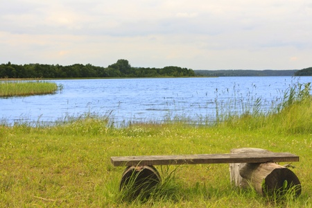braslav: Wooden bench on the shore of beautiful Lake in Braslav Stock Photo