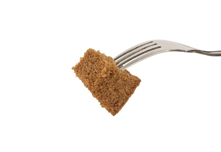dearth: Slice of bread on a fork isolated Stock Photo