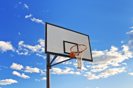 Basketball hoop outdoors on a background of blue sky photo
