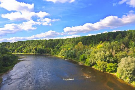 Forest river and a beautiful blue sky with clouds landscape Stock Photo - 15139547
