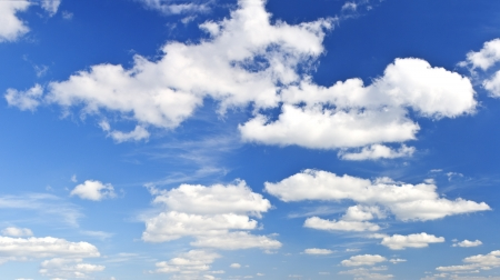 Many beautiful clouds on blue sky background