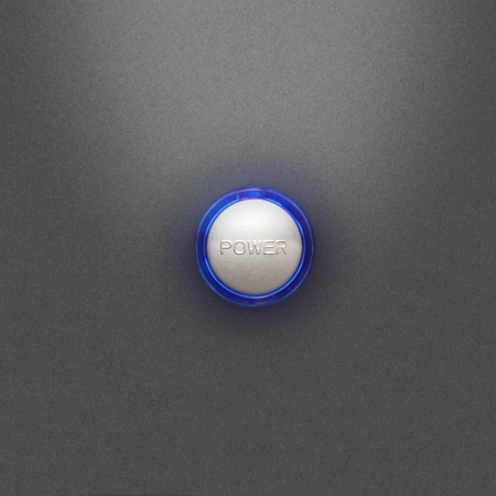 Illuminated power button on the front PC board on a gray background photo