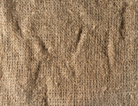 Brown cloth sack texture close-up with the fibers photo