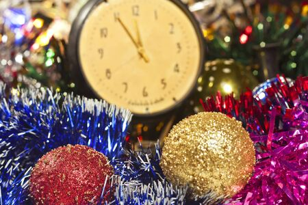 Happy New Year with Christmas toys and old clock photo