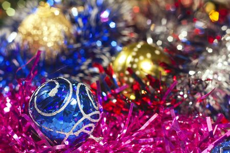 Blue and other Christmas balls and colored tinsel photo