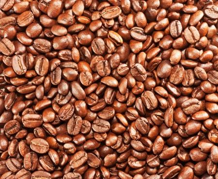 frijoles: Una gran cantidad de granos de caf� tostado de fondo Foto de archivo
