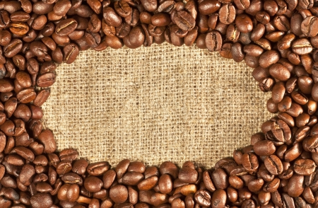 Coffee beans on sackcloth with oval frame Stock Photo - 16062838