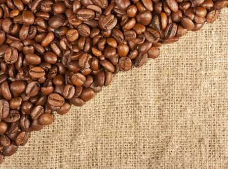 A lot of roasted coffee beans on sackcloth and place for an inscription Stock Photo - 16062837