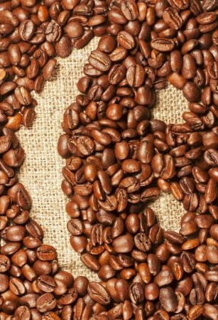 Cheerful smiley painted on roasted coffee beans photo