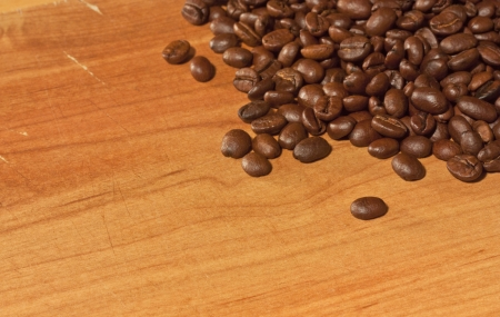 Roasted coffee beans on grunge wood background photo