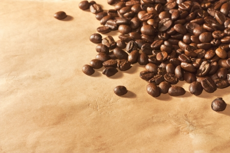 Pile of coffee beans on old paper photo