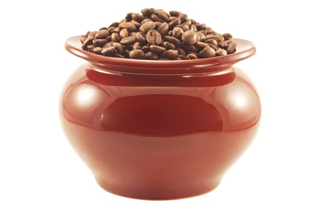Coffee beans in a brown clay pot, side view isolated photo