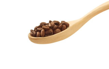Wooden spoon with coffee beans top view isolated photo