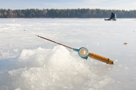 Fishing rod for winter fishing is on the ice Stock Photo - 17358803