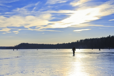Fishermen on a frozen lake in the winter fishing