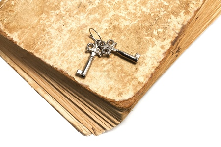 silver eared: Old book and a bunch of keys isolated on white background Stock Photo