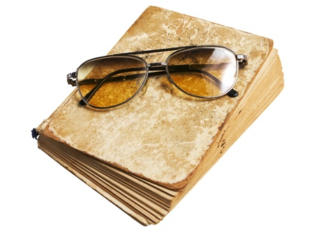 Old book and glasses on a white background Stock Photo - 17570415