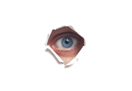 Human eye, seen through a hole in the wall isolated photo