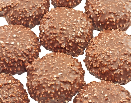 Cookies covered with chocolate and nuts close up isolated photo