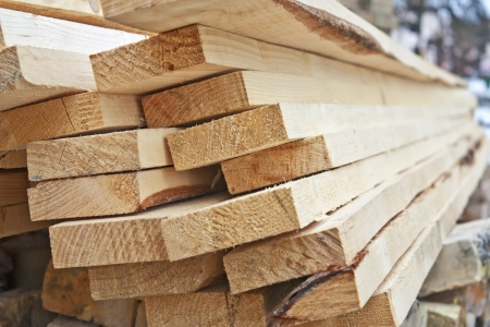 A large pile of wooden boards stored in a sawmill Stock Photo
