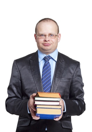 Teacher in a suit and glasses holding a book in his hands isolated on white background photo