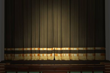 show off: The curtain on the stage in the theater with the lights off