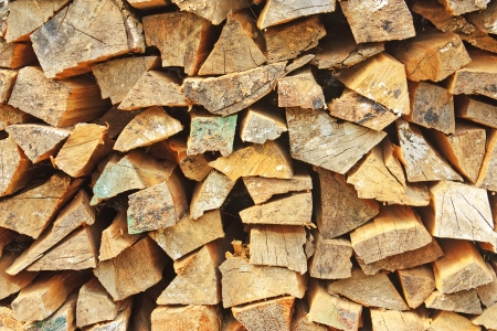 neatly stacked: Stack of firewood neatly stacked close-up background Stock Photo