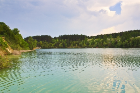 horisontal: Lake on the chalk quarry landscape in Belarus horisontal