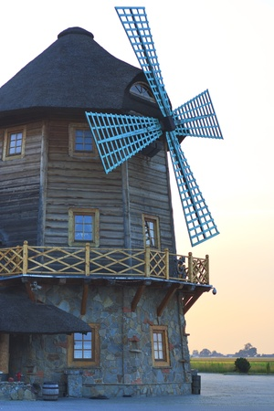 Old wooden windmill on the road in the village photo