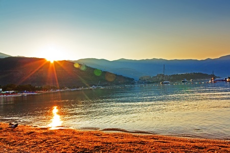 The meeting dawn on the beach in Budva Montenegro photo
